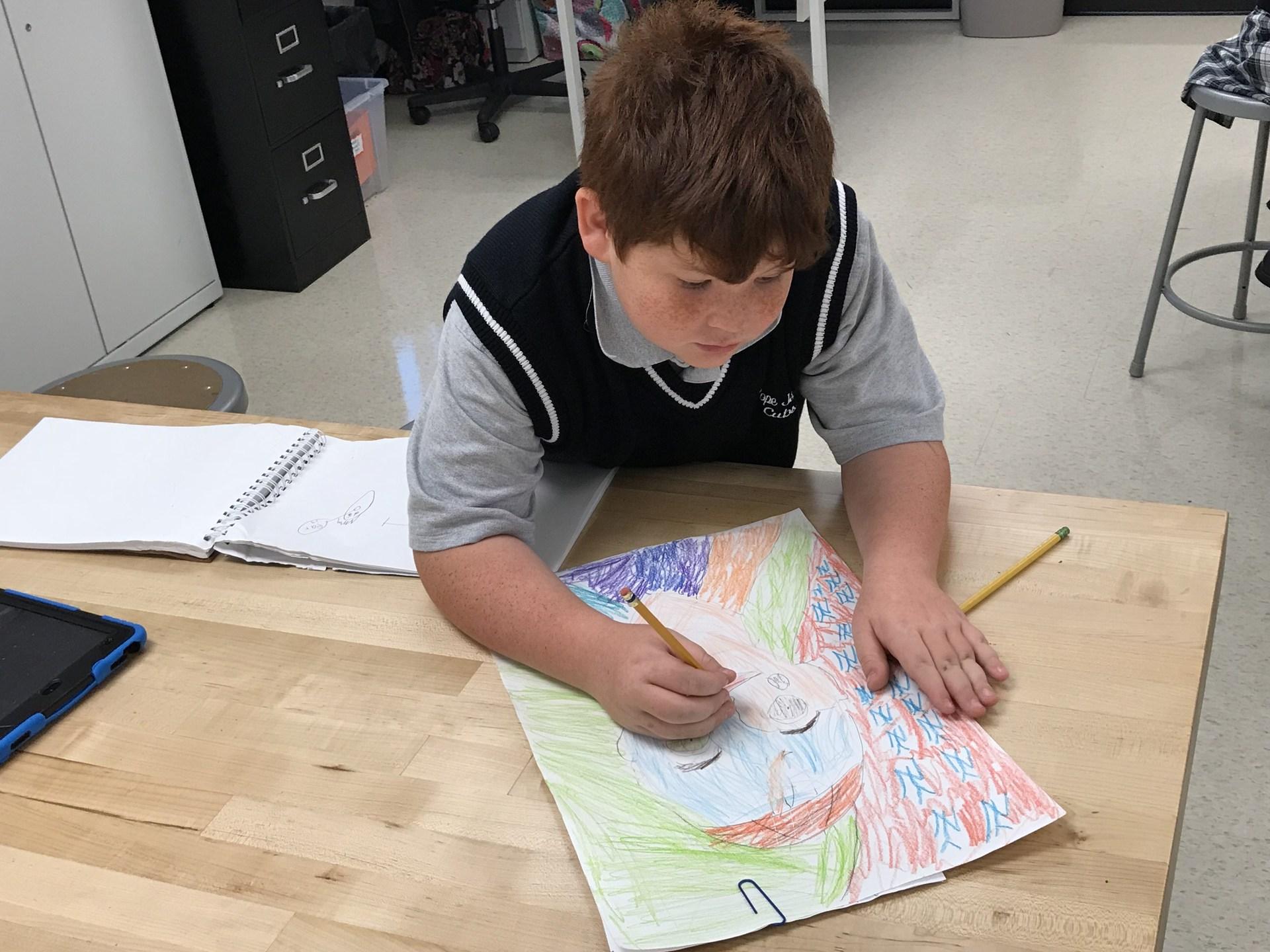 Boy beginning drawing