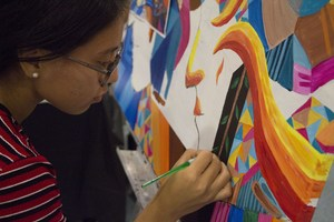 students working on her art
