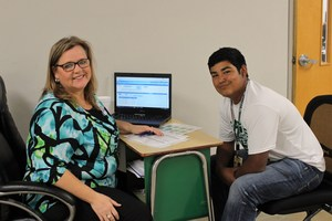 counselor helping student in computer lab