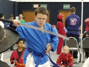 karate tournament student competing
