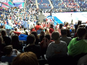 Students, parents, and staff members watching a basketball game at the Greensboro Coliseum.