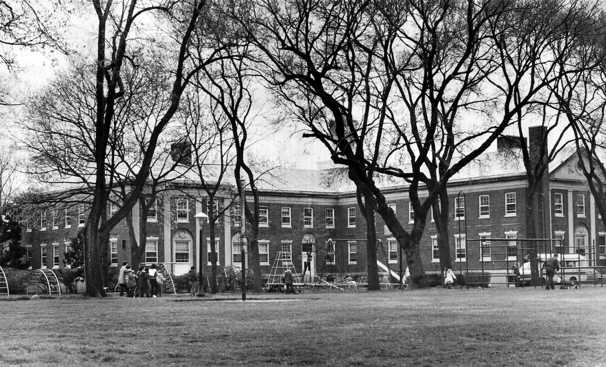 Van Cleve Hall from inner campus showing the original playgrounds.
