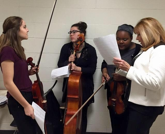 Freshman music students talk before competition
