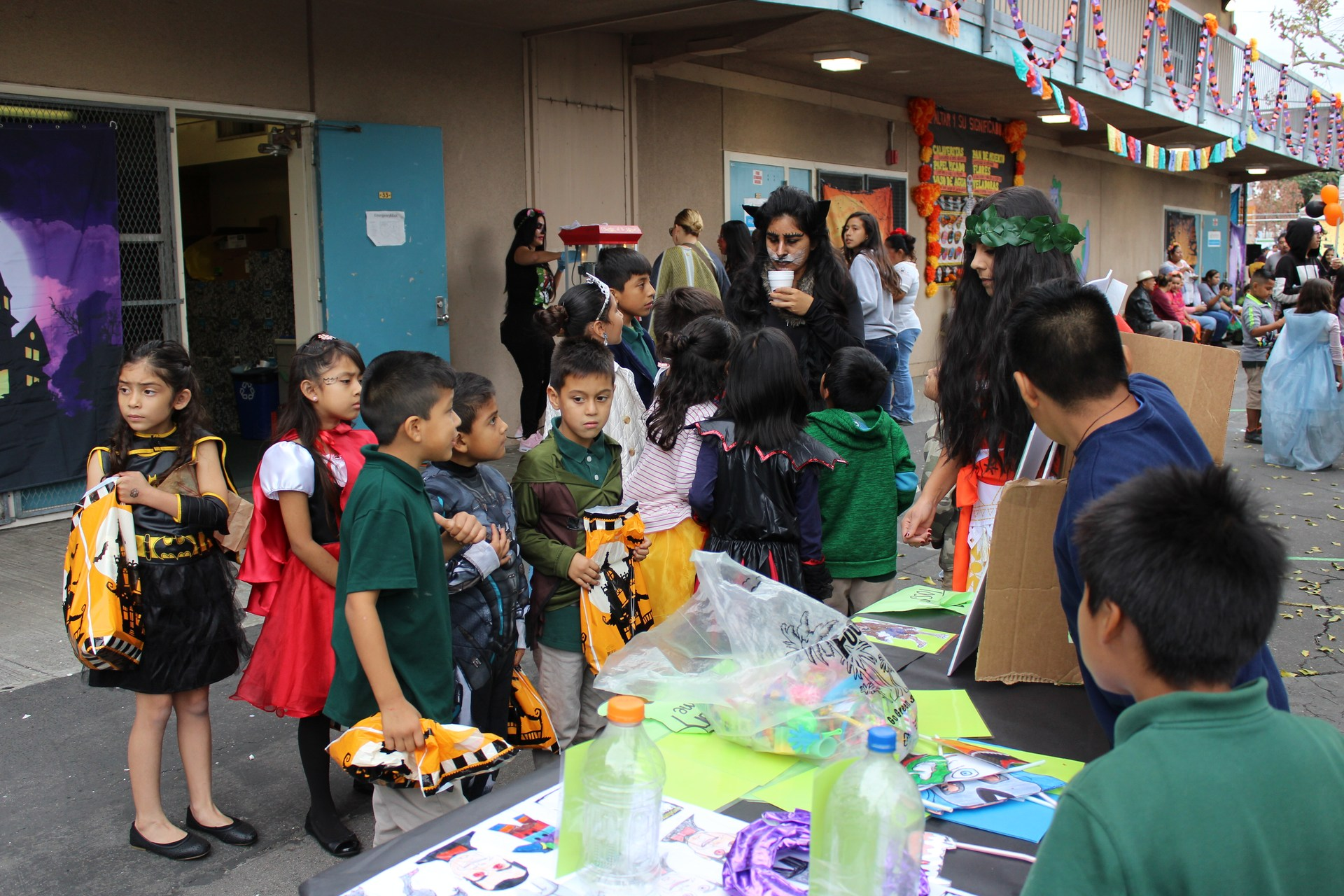 Students engaged in Halloween carnival