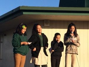 Four girls giving a speech