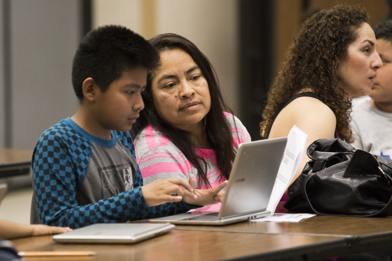 Student and parent on computer