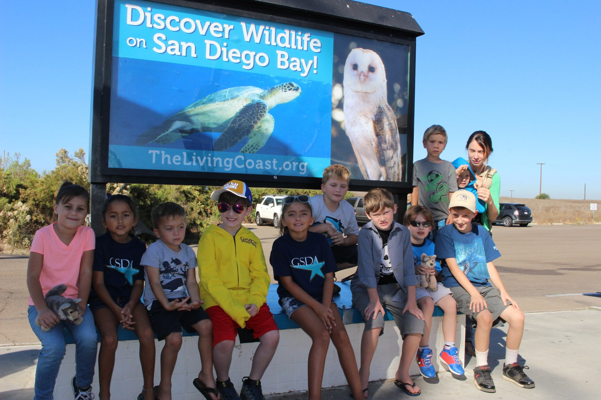 students in front of Living Coast Discovery sign