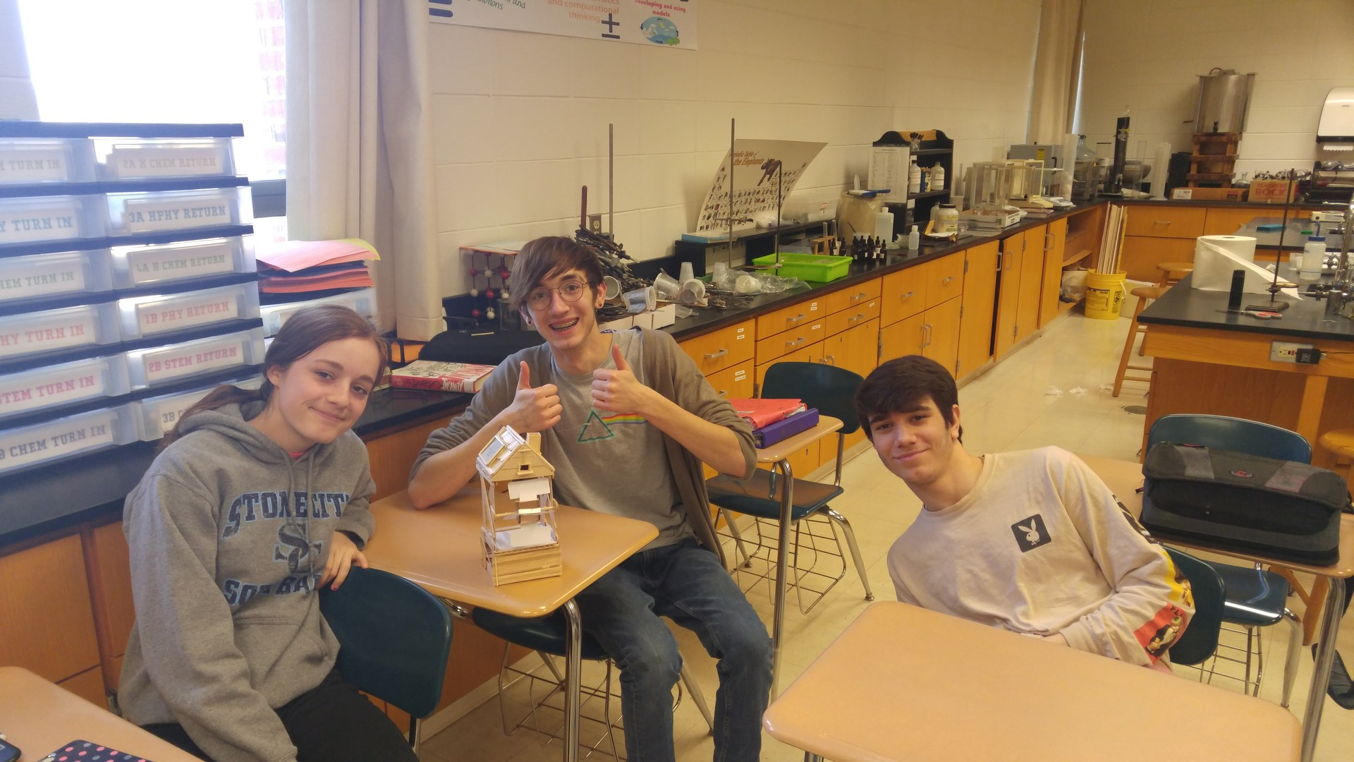 Students in Science of the Modern World showing off their wind turbine.