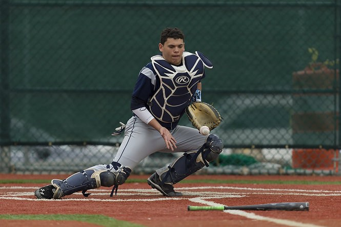catcher trying to catch ball
