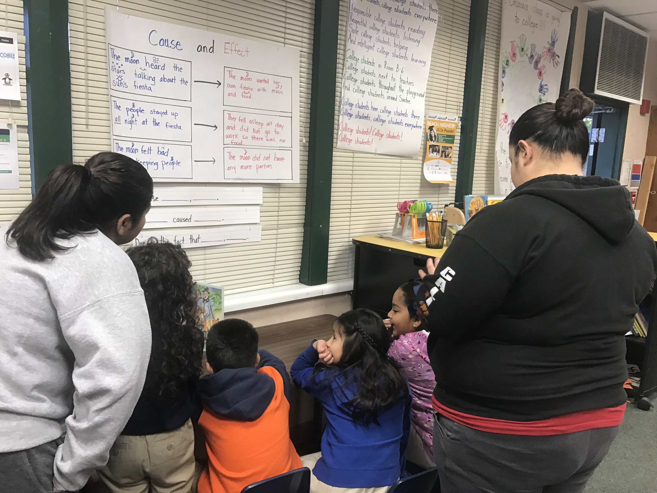 Students discuss cause and effect with their parents.