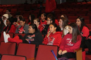 Hazel's teammates watching in the audience.