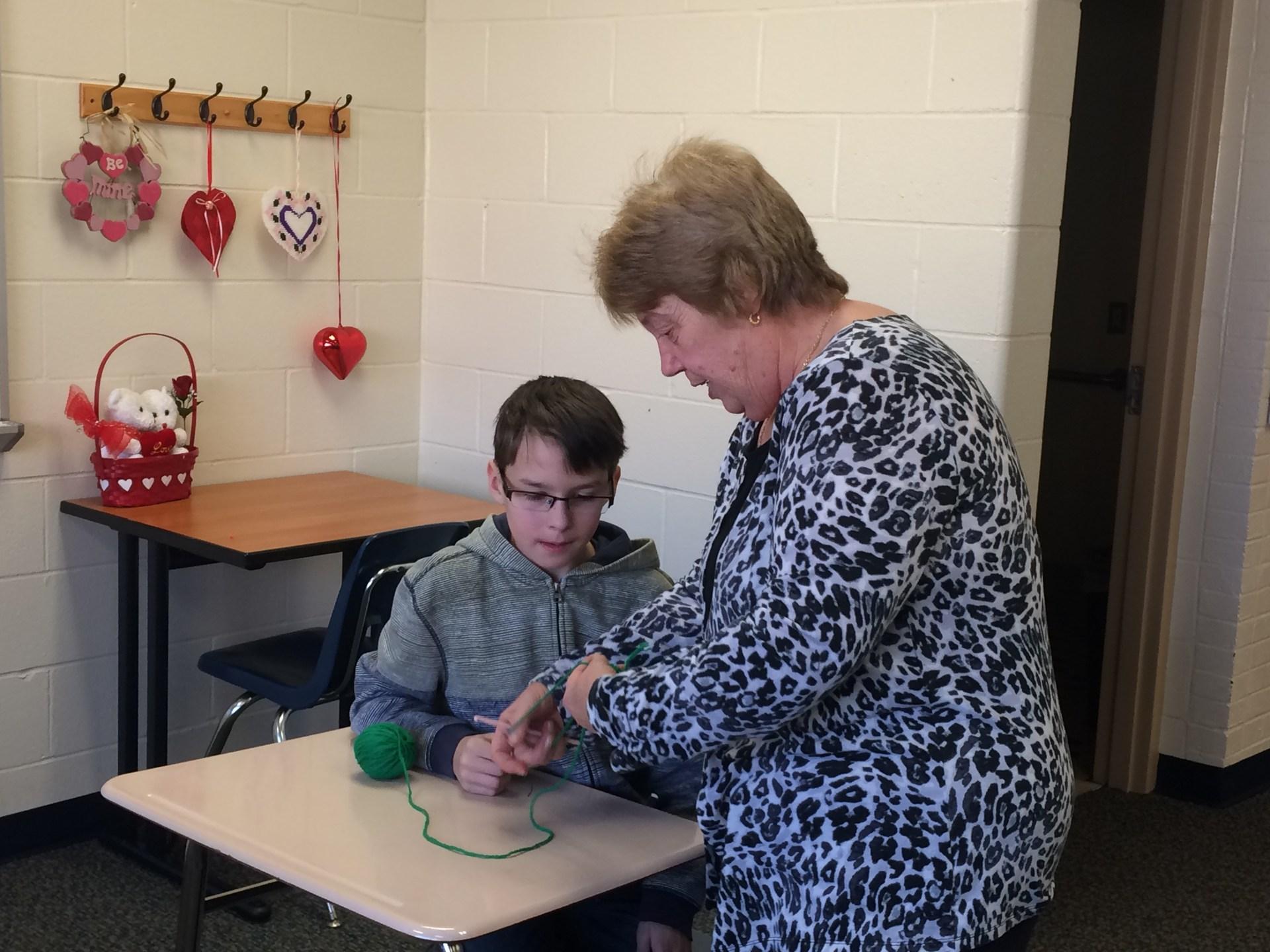 Mrs. Laws runs an enrichment class in knitting.