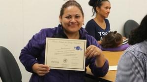 Rosa De La Cruz posing with her certificate