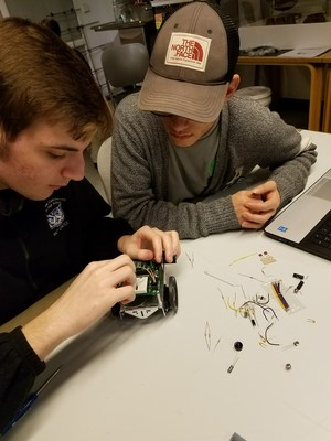 Students working on robots