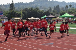 Vineland Elementary students from kindergarten through sixth grade dash to complete the last mile of a 26.2-mile marathon in May as part of Rod Dixon's Kids Marathon Run Club.