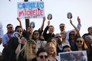 More than 1,000 attendees brought vibrant signs and photos of grads to cheer on the 408 seniors in Sierra Vista High School's graduating class of 2017. The event took place at the school's stadium on June 1.