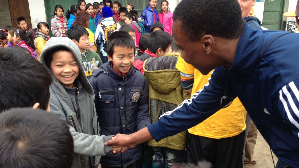 A Sandia Prep students greet a child in another country