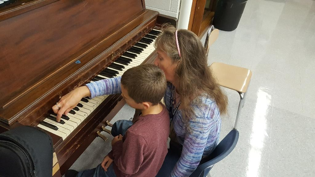TA and student at Piano