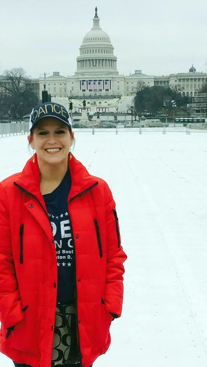 Female posing in front of U.S. Capitol