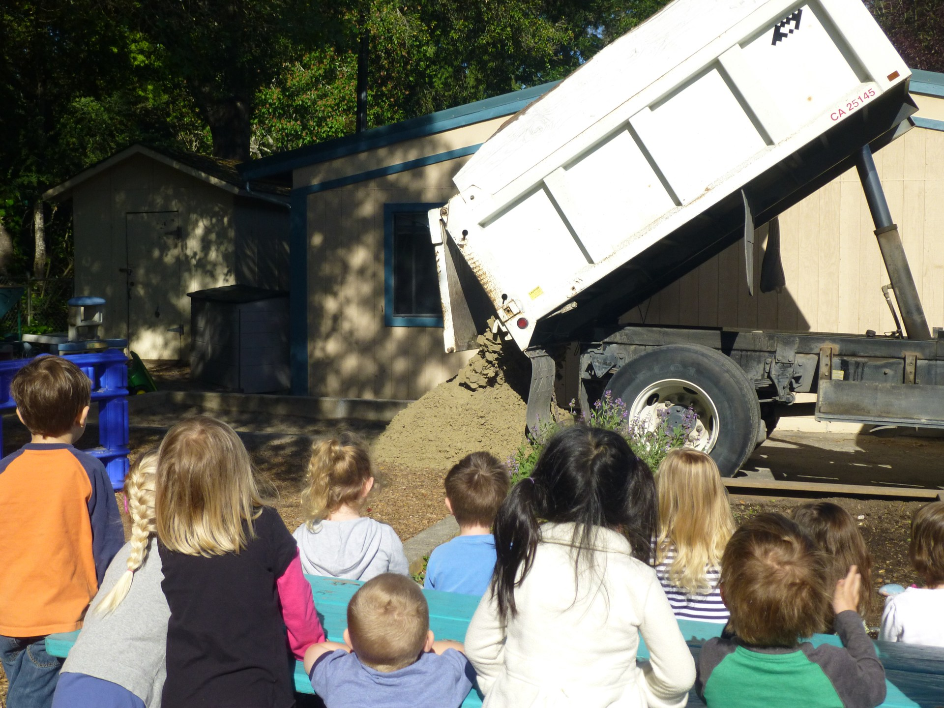 Students watching dumptruck