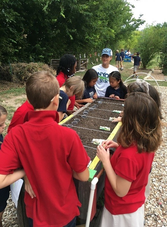 Parent Volunteer Leading a Garden Lesson