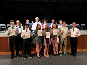 13 students holding NHS certificates