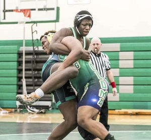 Coloma's Billy Boyd, front, wrestles against Berrien Springs' Tyree Spann