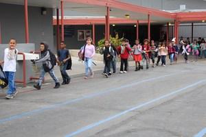 After school students line up for egg hunt