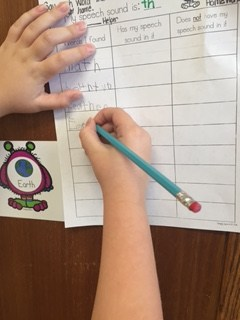 Photo of student writing words.
