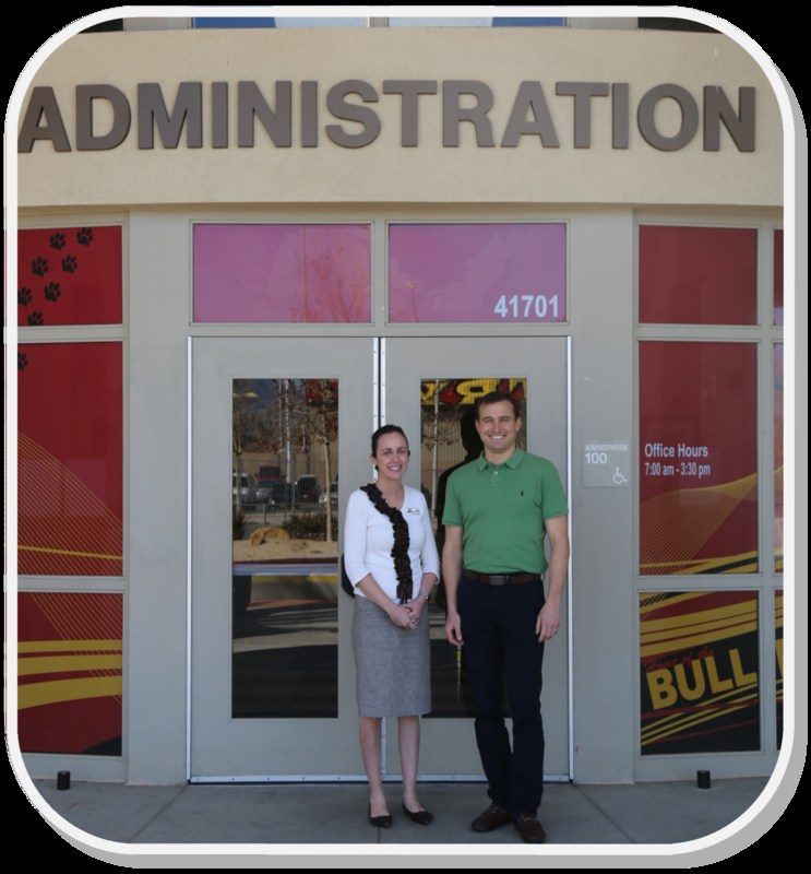 Danielle Cisneros and Jake Simmons in front of a Hemet High sign.