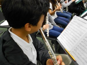 Students playing their flutes in band.