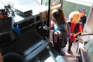 Photo of student using ID to scan onto bus.