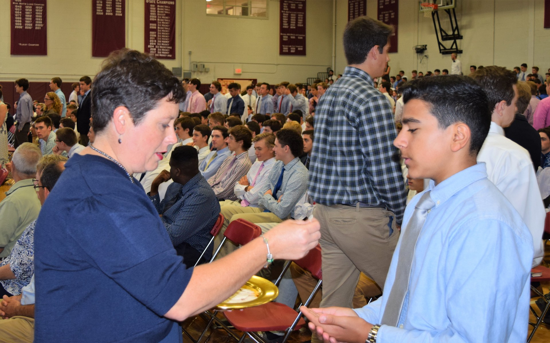 Student receiving communion
