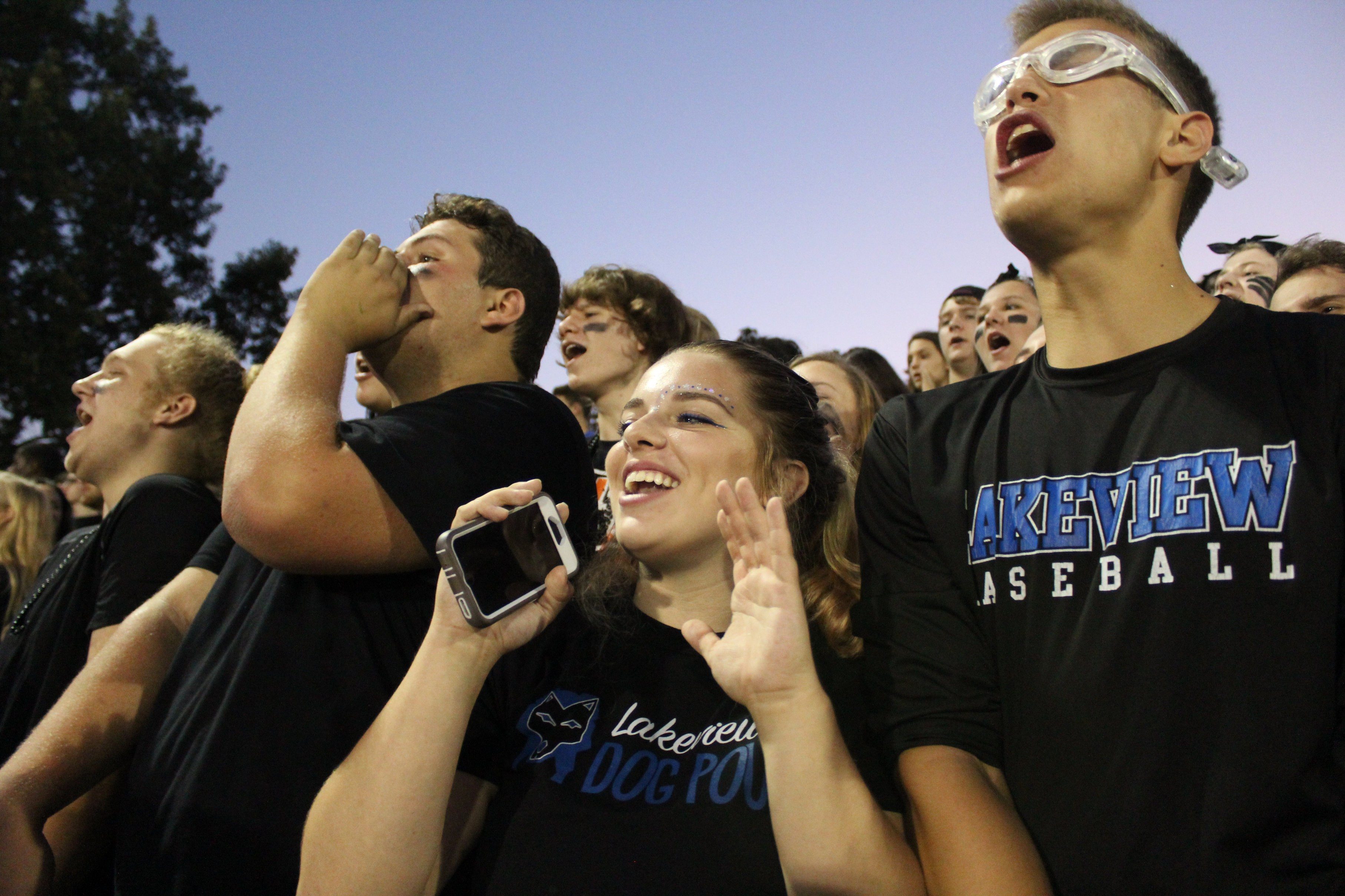 LHS students cheering during a football game