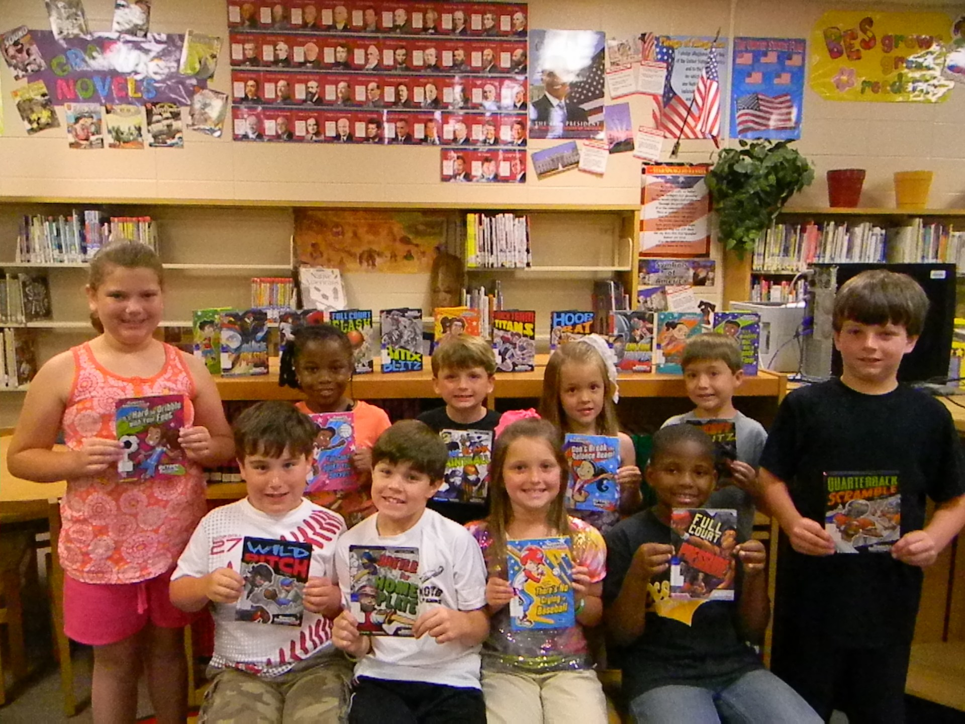 BES students excited about new sports books in the library.
