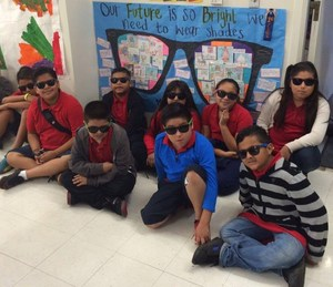 Elwin Elementary students, wearing shades, stand their first-place poster at the second annual East San Gabriel SELPA CAC Festival of the Arts on Oct. 24.