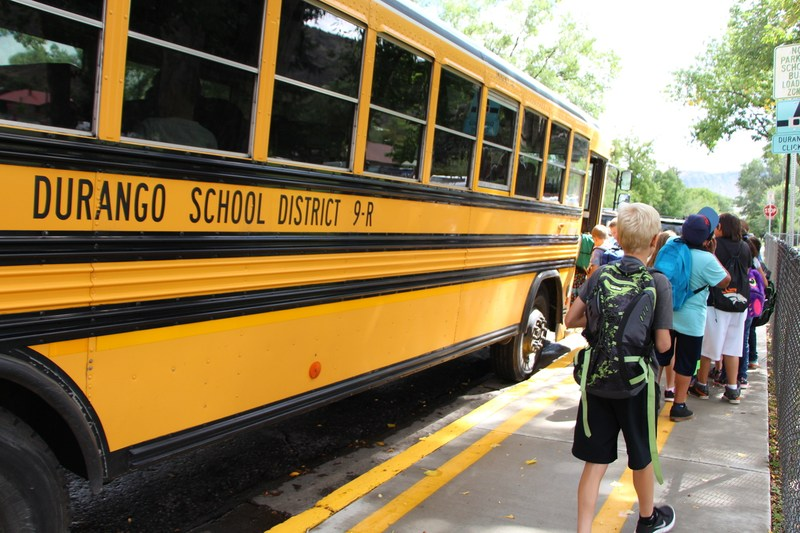 Students getting on school bus.