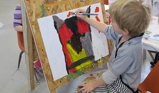 Students painting at DAC.