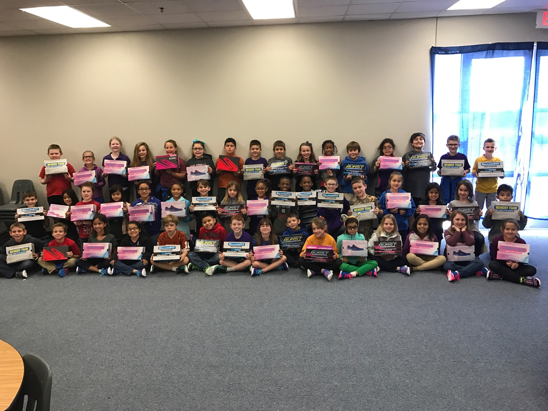BHE students with their free shoes provided by Cowtown.