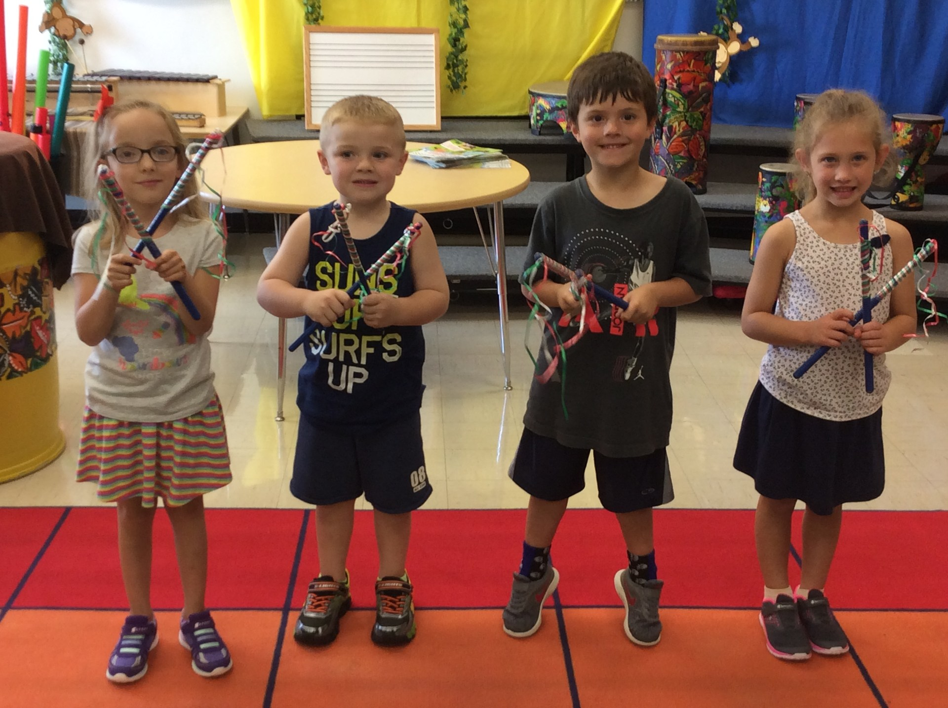 Kindergarten playing rhythm sticks