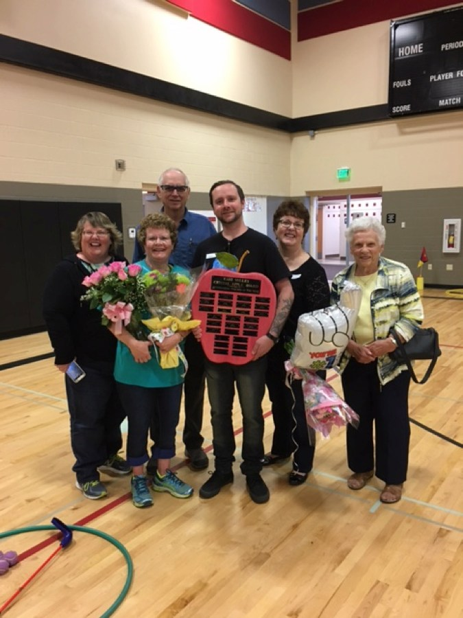 Mrs. Julie Milburn (2017 Winner) - District Music Teacher. Accepting her award with family at Terrace Heights Elementary.