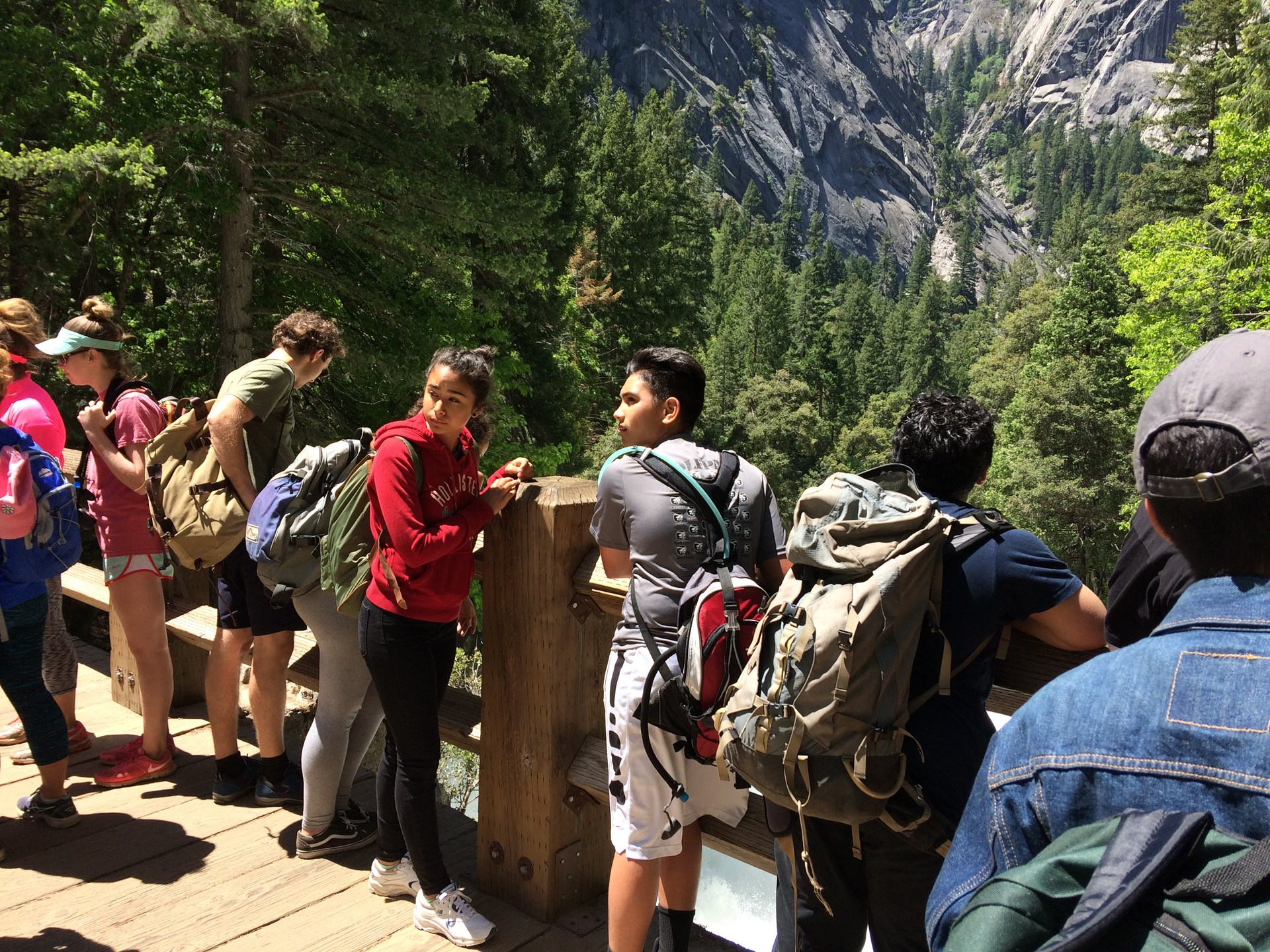 students stand at a lookout at Yosemite