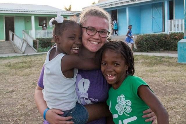 Jamie Sullivan with two Haitian children.