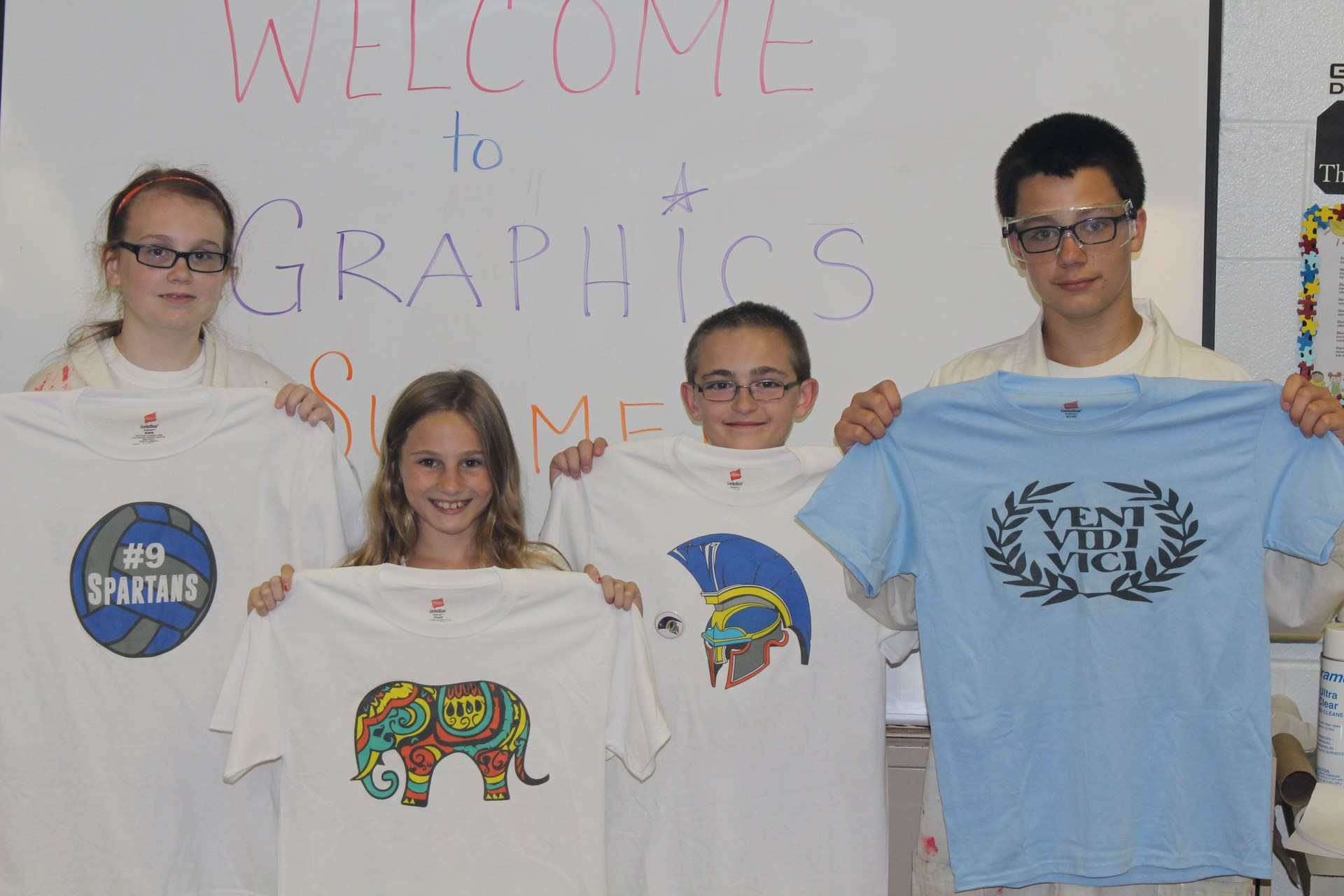 Students learning about Advertising and Graphic design