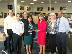 Alhambra Unified School District and the YMCA receive a donation of 48 laptops each from Howard's Appliance and Flat Screen Superstore in Alhambra.