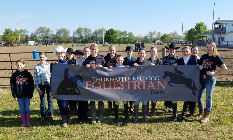 Members of the TK Junior Equestrian Team won first place honors a the district meet.