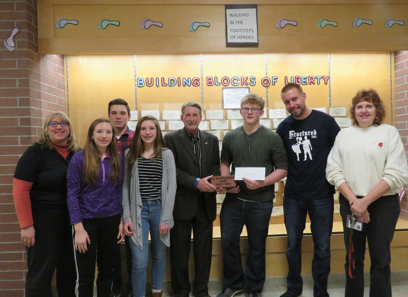 Eighth graders make a donation to the Middleville Veterans Memorial.