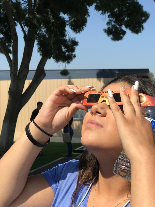 Student looks at the eclipse