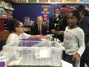 CEO Vince Bertram sitting with students working on PLTW project at Belvidere