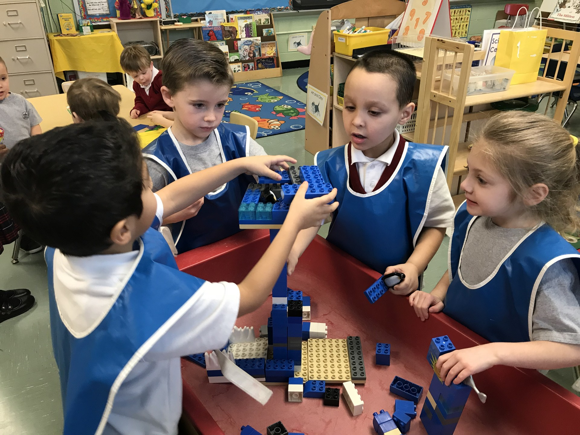Students building a ship with legos